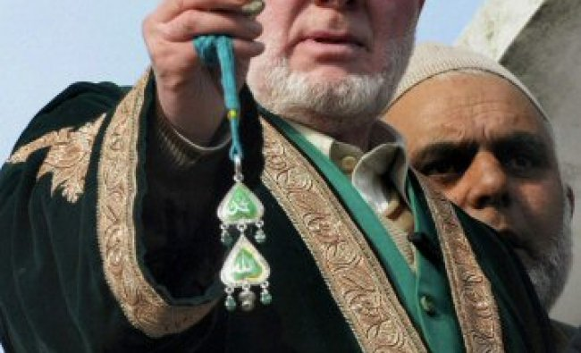 The head priest at Hazratbal Mohd Yasin Banday showing the relic of Prophet Muhammad...