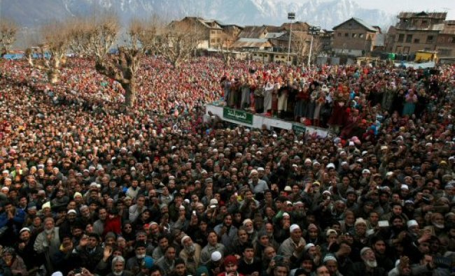 Devotees pray while having a glimpse of the relic of Prophet Muhammad...