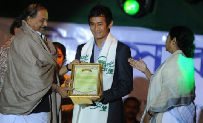 Indian footballer Baichung Bhutia is greeted by chief minister of West Bengal Mamata Banerjee