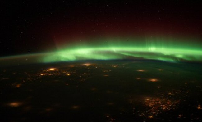Aurora Borealis in this nighttime photograph shot from the International Space Station