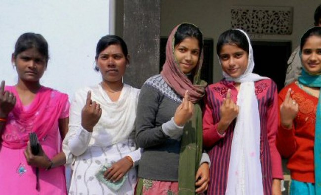 First time voters show their marked fingers after casting their votes...