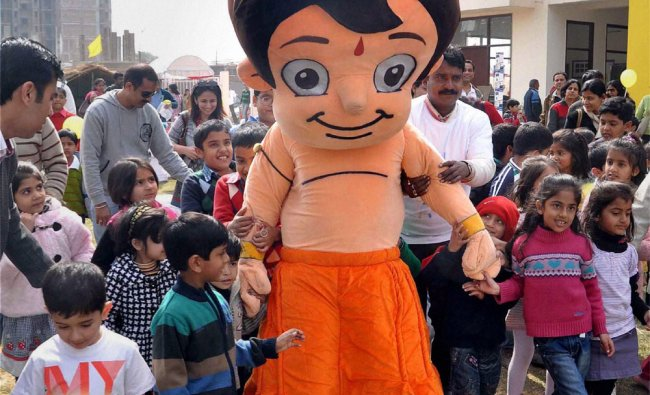 An actor, dressed up as TV character Chhota Bheem, entertains children at a school in Gurgaon