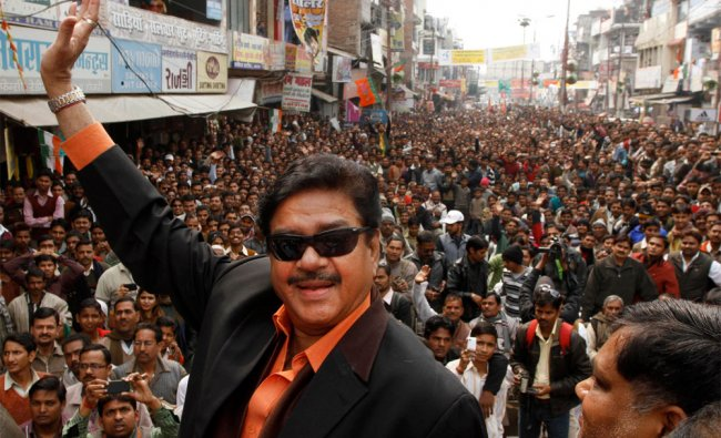 Bollywood actor Shatrughan Sinha, waves to the crowd as he attends an election campaign rally