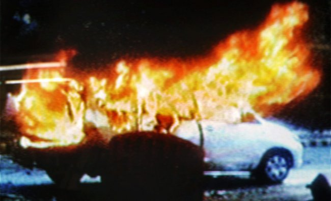 An Israeli embassy car in flames after an explosion