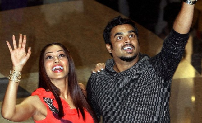 Bipasha Basu and Madhavan wave to fans at an event