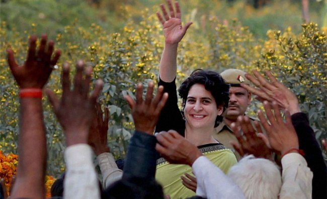 Congress party campaigner Priyanka Vadra waves to people in Unchahar in Rae Bareli