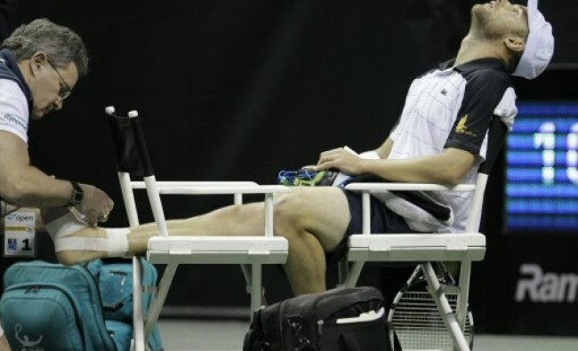 Andy Roddick is taped after he fell over and injured his foot during match against Denis Kudla