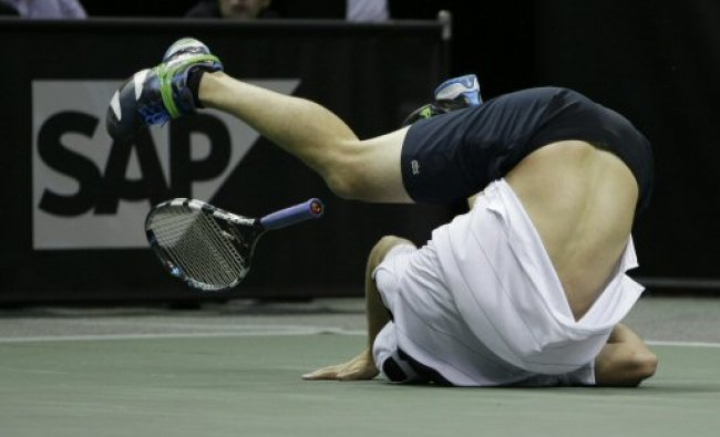 Andy Roddick falls over as he injures his foot during SAP Open tennis tournament