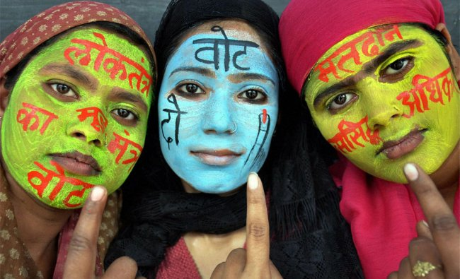 Young girls participate in a voting awareness campaign in Moradabad