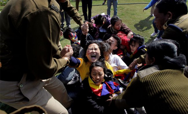 Police detain Tibetan exiles during a protest outside the Chinese Embassy