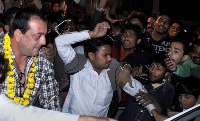 Bollywood actor Sanjay Dutt arrives to attend an election campaign meeting in Lucknow