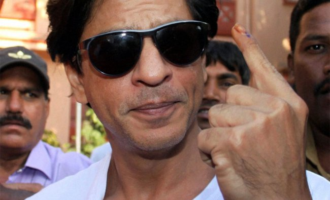 Shah Rukh Khan shows his marked finger after casting vote for the corporation elections in Mumbai