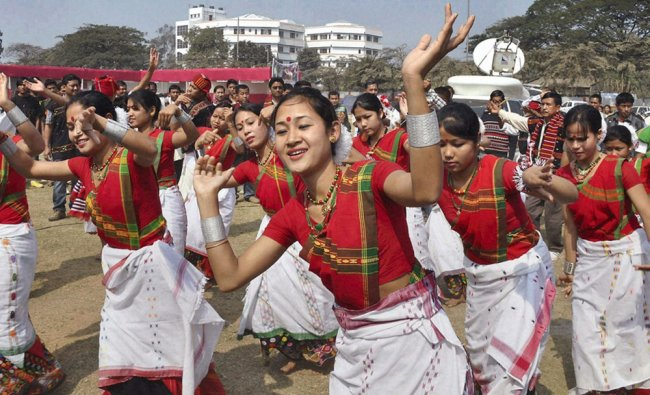 Mising people perform traditional Mising dance during the Ali- Aye-Ligang festival in Guwahati