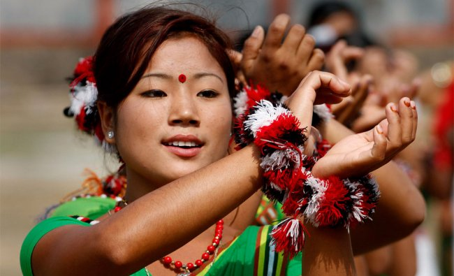 Mising women in traditional attire dance during the Aliai Lrigang festival