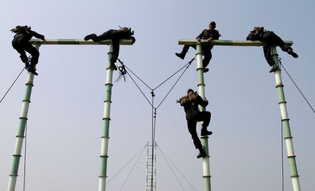 National Security Guards (NSG) soldiers participate in a drill during the inauguration of an NSG Hub