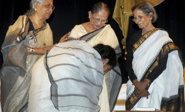 West Bengal Chief Minister Mamata Banerjee seeks blessings of her teachers during a programme