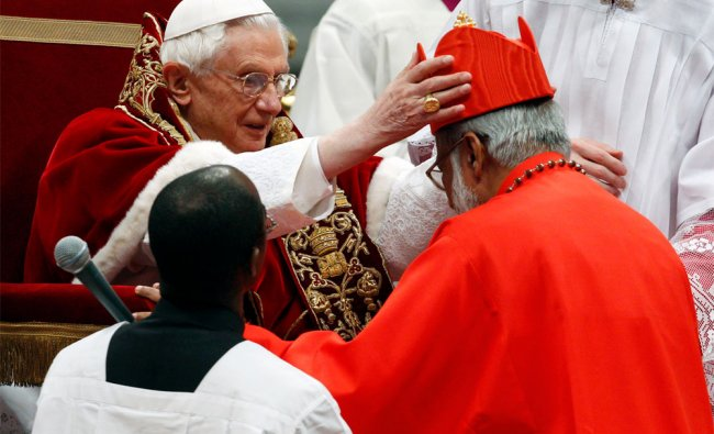 Archbishop George Alencherry, of India, right, receives the cardinal\'s hat from Pope Benedict XVI