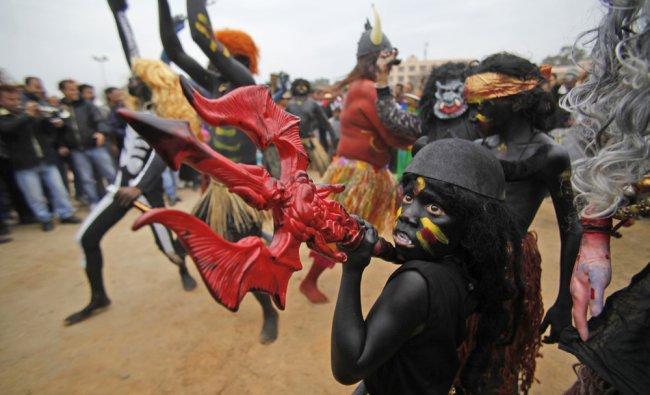 A child dressed as a demon participates in a procession ahead of Shivratri festival