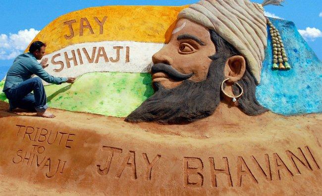 Sand artist Rajesh Muliya creates a sand sculpture of Chhatrapati Shivaji