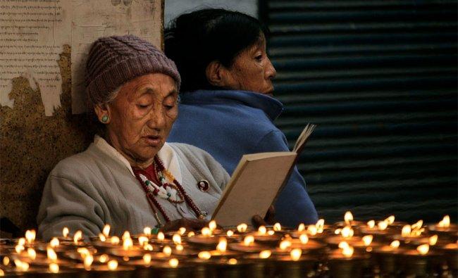 Elderly exiled Tibetan women pray as they mark the Tibetan New Year, in New Delhi