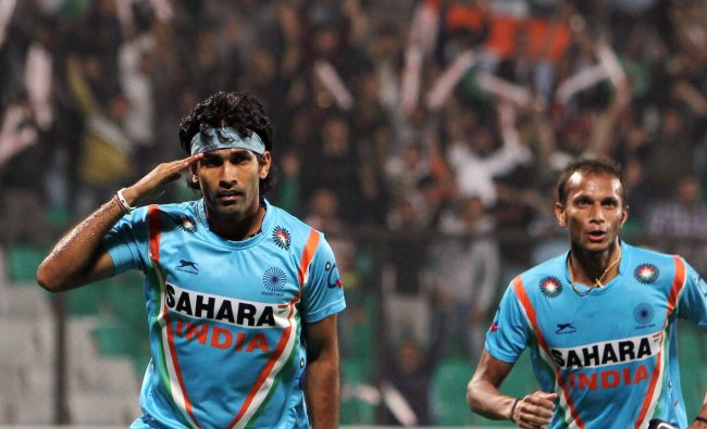 Indain player Shivendra Singh celebrates with Sunil after scoring first goal