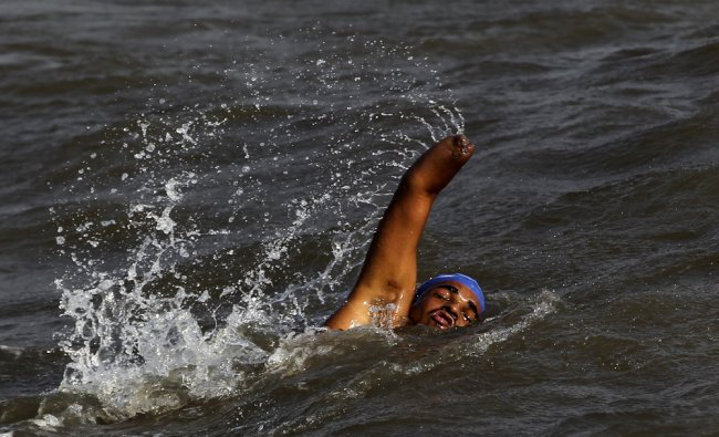 Physically challenged Suyash Jadhav swims during a practice session...