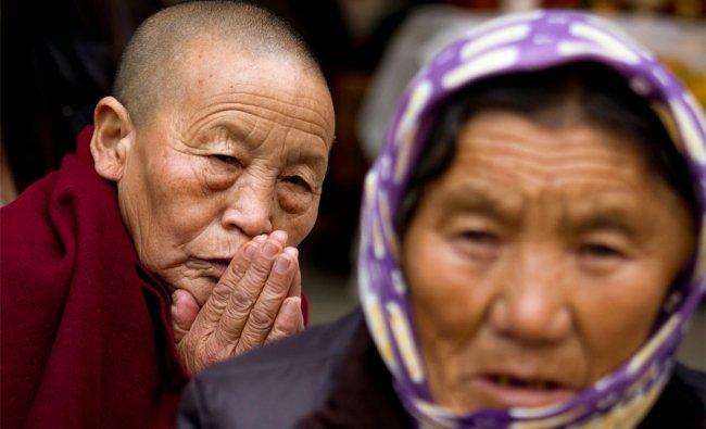 An exile Tibetan Buddhist nun prays on the third day of \