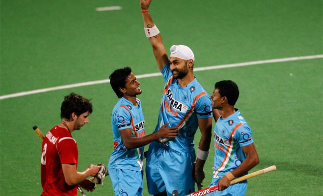 Indian players celebrate the fourth goal against Poland during field hockey Olympic qualifier