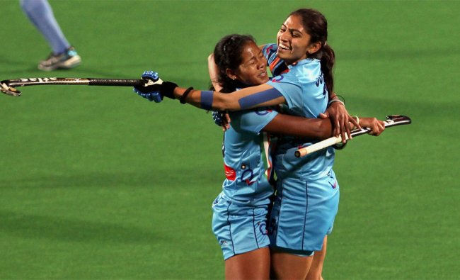 Indian captain Lakra Asunta (L) celebrates with Joydeep Kaur after defeating Italy by 1-0
