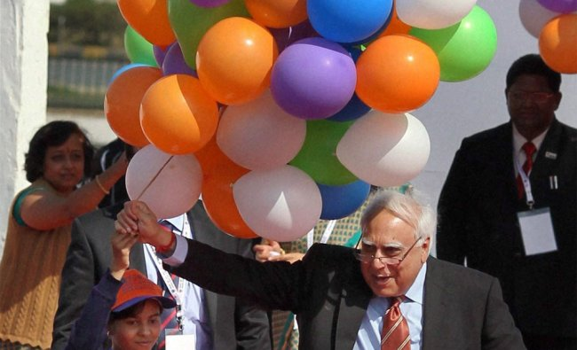 Union HRD Minister Kapil Sibal releases balloons during inauguration of \