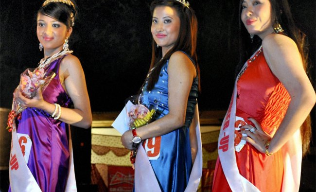 Miss Sikkim contest winner Zennyla Bhutia poses for photographs with first and second runner ups