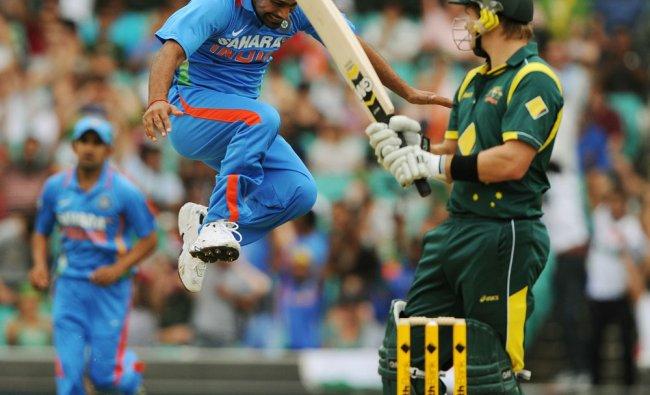 Praveen Kumar celebrates after taking the wicket of Australia\'s Shane Watson