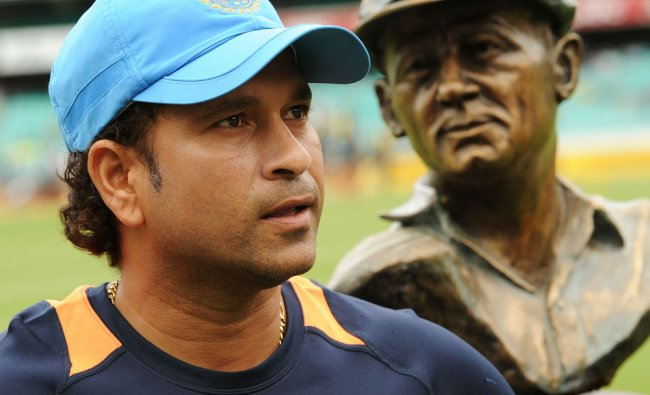 Sachin stands in front of a bust of Sir Donald Bradman as he receives an Honorary SCG Membership