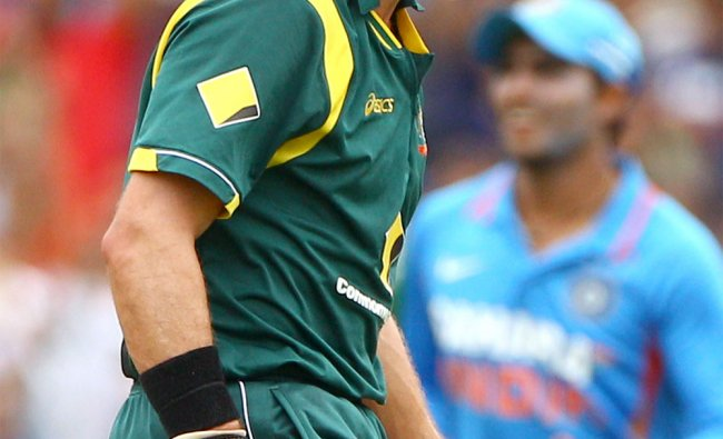 Australia\'s Michael Hussey reacts after he was run out for 10 runs