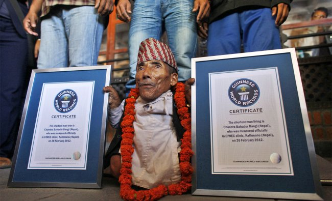 Chandra Bahadur Dangi poses after being declared the world\'s shortest living man