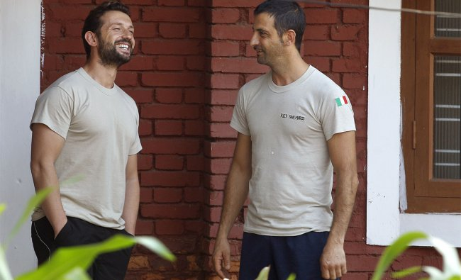 Italian marines share a light moment at the government guest house in Kochi