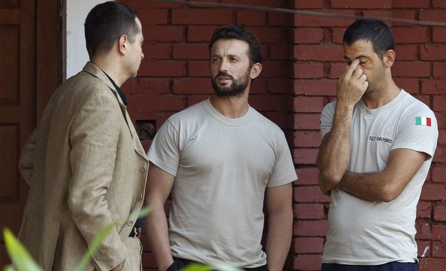 Italian marines talk to an unidentified person outside a government guest house in Kochi