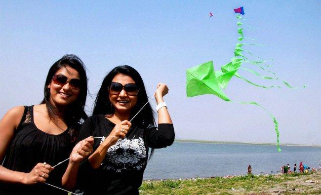 Actress Aimee Barua and Rimpi Das flying kites