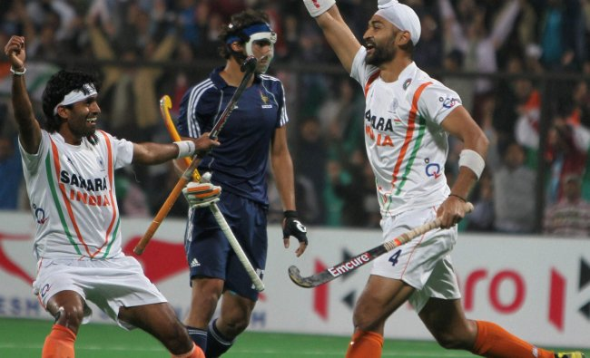 India\'s Sandeep Singh(R) celebrates during the Olympic qualifier (men) hockey match
