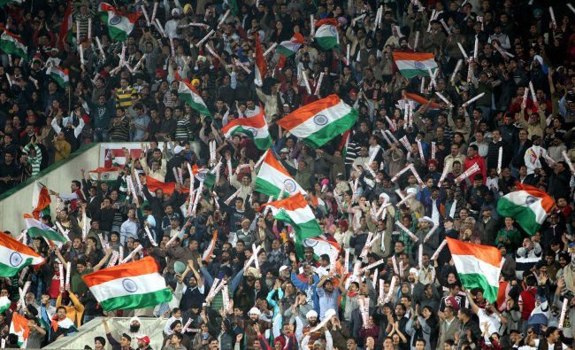 India\'s supporters celebrate after India\'s third goal against France during the Olympic qualifier