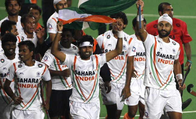 Indian players celebrate during Olympic Qualifying men hockey in Delhi