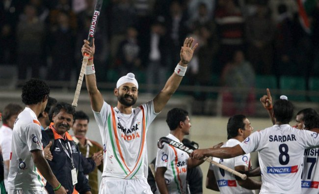 Indian player Sandeep Singh (c) celebrates after beating France