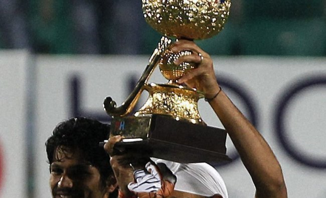India\'s Sandeep Singh lifts a trophy after beating France