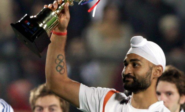 India\'s Sandeep Singh celebrates with highest scorers trophy