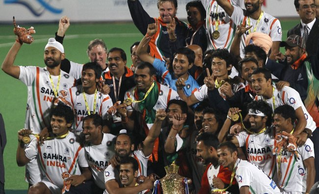 Indian players celebrate with winners trophy after beating France