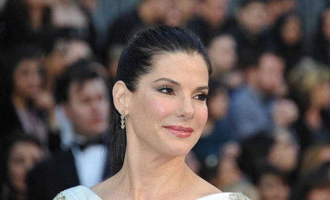 Actress Sandra Bullock arrives on the red carpet for the 84th Annual Academy Awards