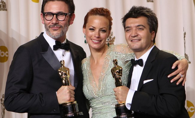 Michel Hazanavicius, left, poses with his award for best director for \