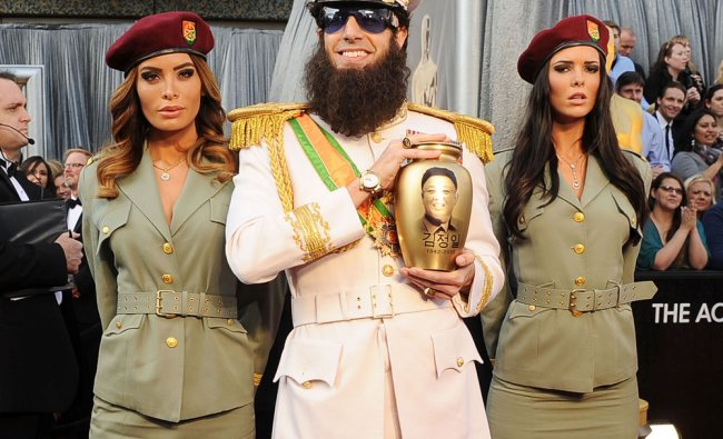 Actor Sacha Baron Cohen, dressed as his character \'General Aladeen,\' arrives at the Oscars