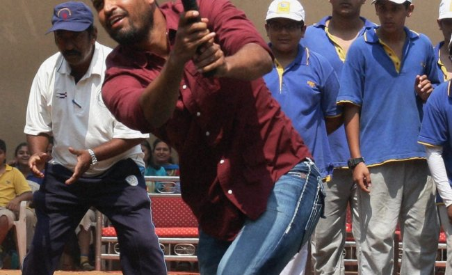 Cricketer Yusuf Pathan plays during a visit to a school