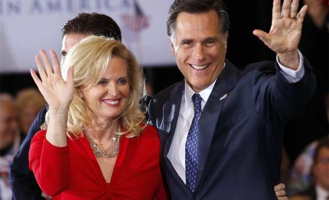 Mitt Romney, waves to supporters with his wife Ann after winning the Michigan primary